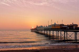 seaside sunrise dramatic sky pier