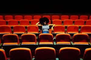 seats sitting orange theater rows auditorium bored opera chairs indoors