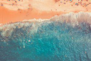 shore people sand drone shot swimming seashore ocean landscape swimmers summer
