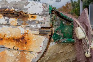 shoreline broken seaside scenic wooden hull boat wood deserted shore coastal
