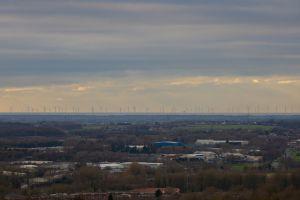 skelmersdale light sun rays landscape beacon country park sky wind farm