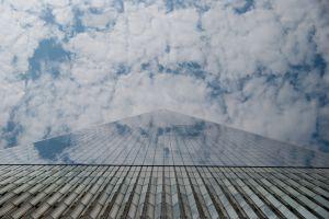 skyscraper blue wtc new york sky high manhattan reflection glass clouds
