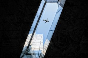 skyscraper urban architectural city blue sky light reflections airplane