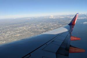 southwest airplane wing ocean airplane landscape birds eye view blue skies clouds
