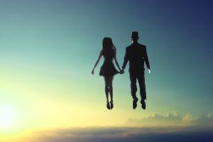 sun woman couple backlit man people floating levitation flying