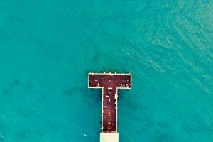 sunrise ocean turquoise beach pier