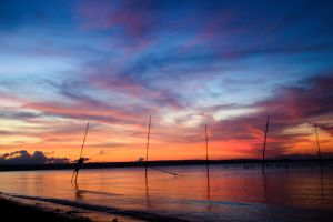 sunset beach fish pens horizon clouds sunset