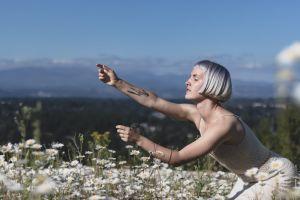 tattooed beautiful short hair flower field posing blooming side view nature delicate gesture