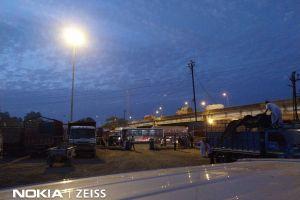 vehicles road light evening sky