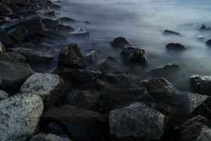 water coast stones nature long exposure