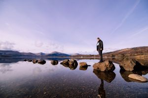 water person nature calm sky reflection clear water man daylight rocks
