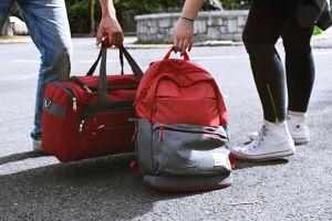 wear footwear street hands road duffel bag luggage people color daylight