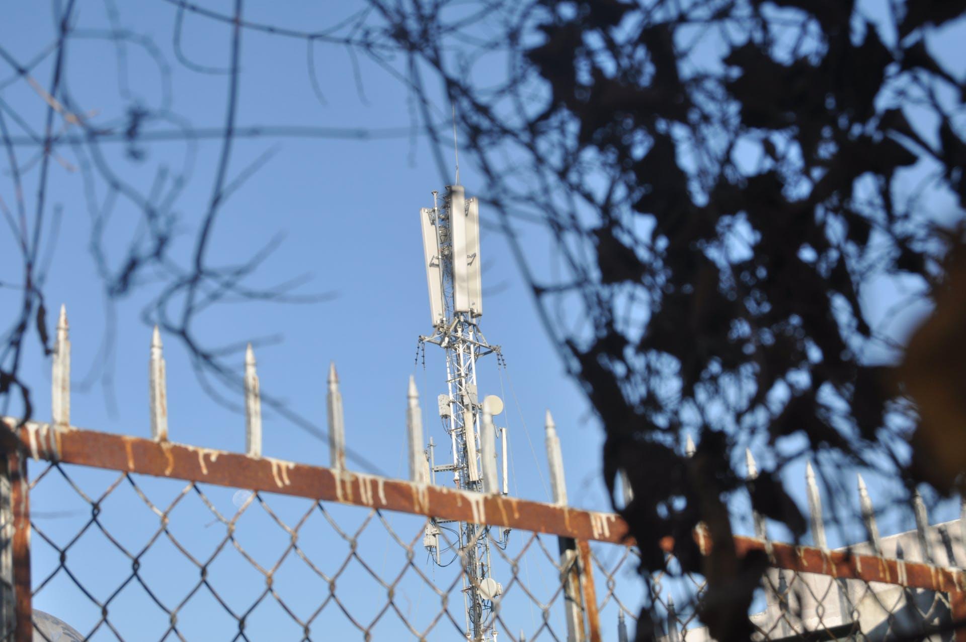 wireless blur outdoor mobile pattern depth of field blue background telephone pole fence pole