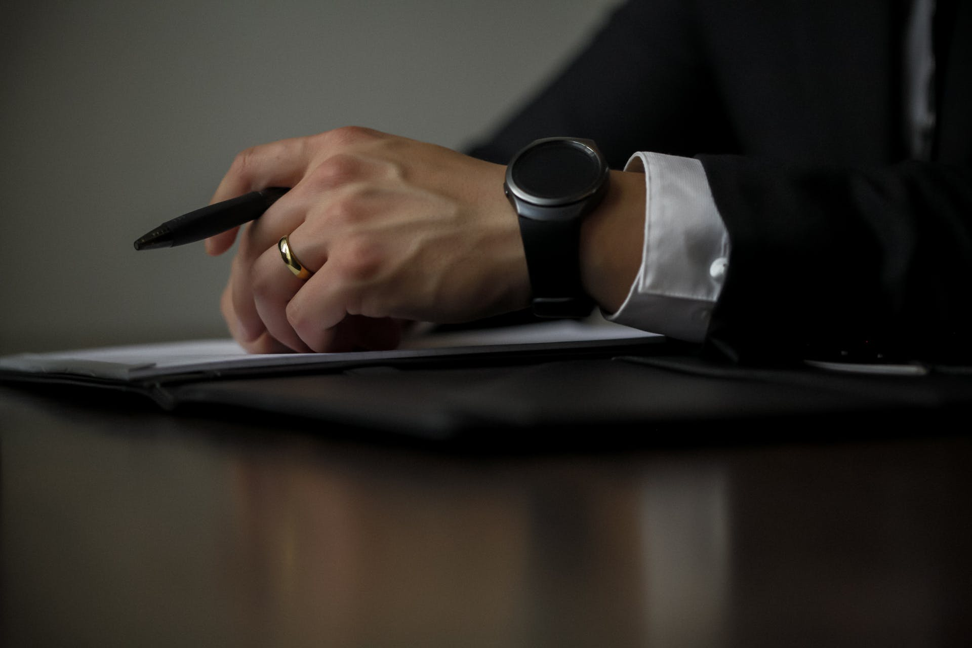 composition hand ring reflection person time man work home office corporate attire