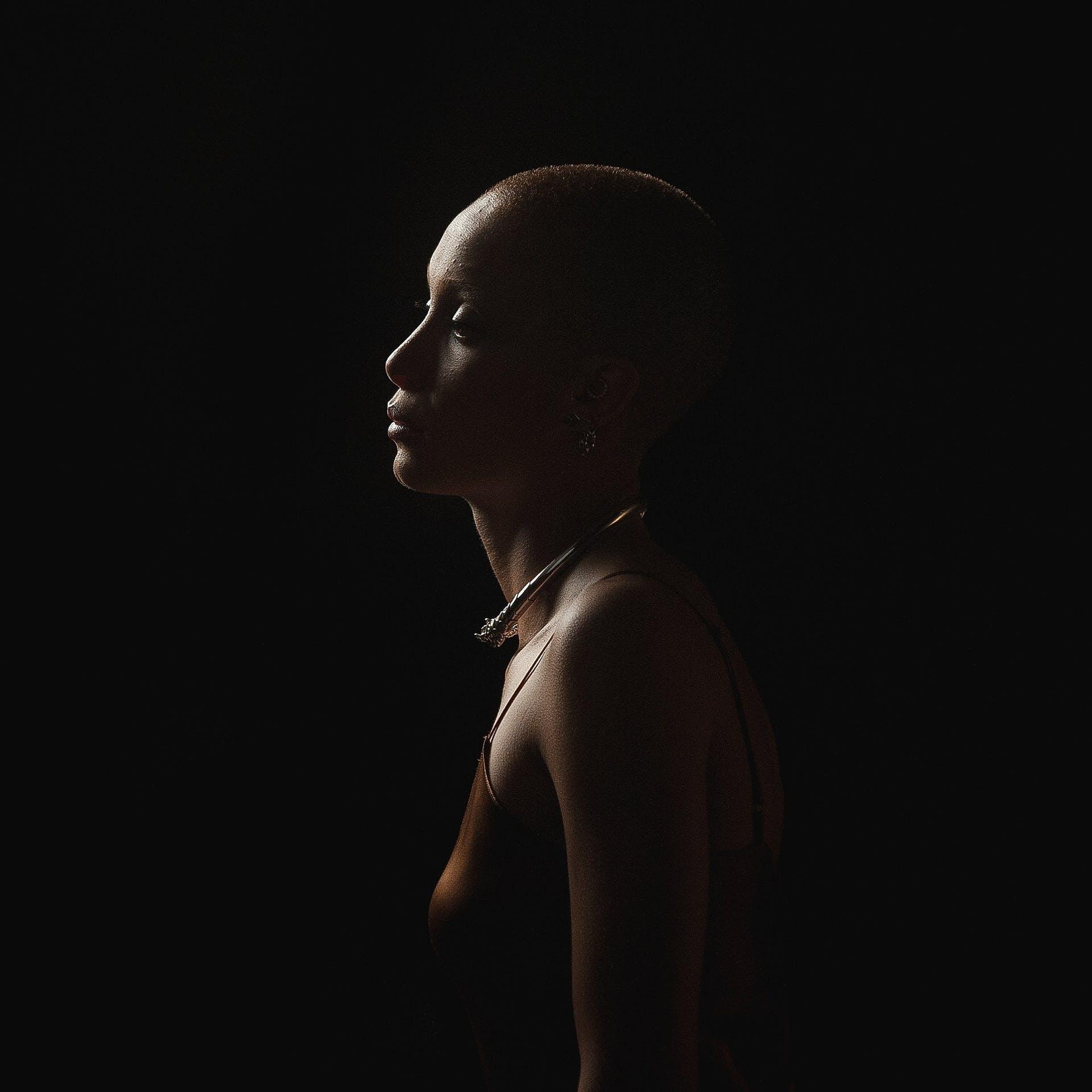 fashion lady bald photoshoot model sexy necklace shadow dark female