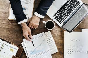 agenda pen businessman indoors analysis hands workplace paperwork office technology