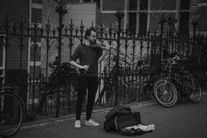 amsterdam building city violinist person
