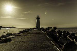 beach early morning lighthouse ocean