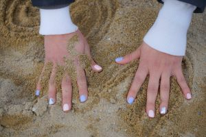 beauty sand white craze nails woman adventure beach art tshirt