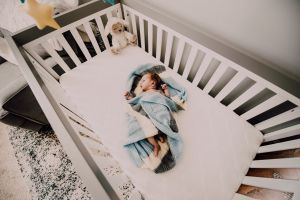 bed person cute crib room bedroom child little baby