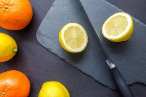 black background round out lemon fruits slice oranges yellow raw citrus citrus fruit