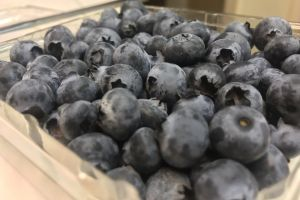 blue fresh produce fruit berries background farmers market texture