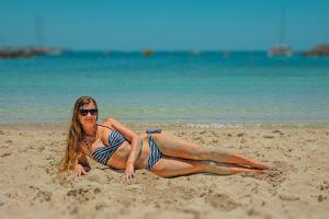 body person sea waves sand seascape shore sunbathing beach female