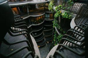 building multi-storey building green black dark futuristic asia metal railings plants design