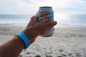 can beach landscape sun hand beachlife beer ocean daytime seashore