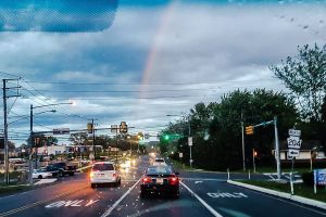 car clouds rainbow windshield traffic road lights