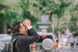 car people lights street daytime eyewear landscape road man urban