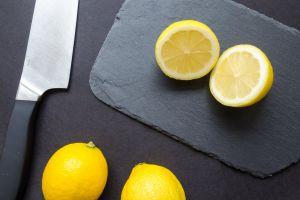 citrus fruit yellow lime lemon fruits healthy close-up black background slice cut
