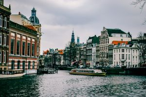 city buildings waterfront water watercraft boat urban canal europe architecture