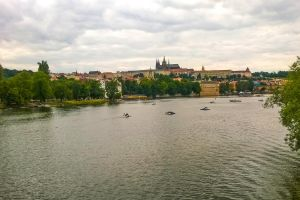 clouds cityscape trees boating church europe bridge landscape people prague