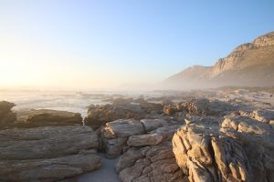 clouds sea rocks holiday sunset waves water ocean background cape town
