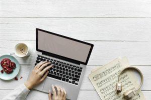 coffee keyboard electronics flatlay music sheet hands headphones laptop