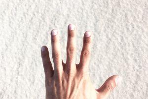 conceptual skin adult fun people sand woman man beach hand