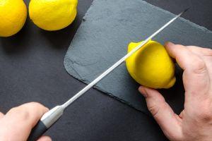 cut citrus fruit slicing juicy kitchen knife lemons fresh slice hands food