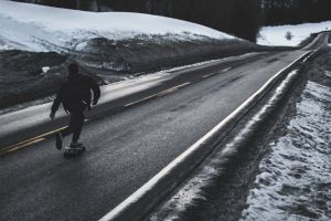 daylight snow wheels ice motion person skater man weather asphalt
