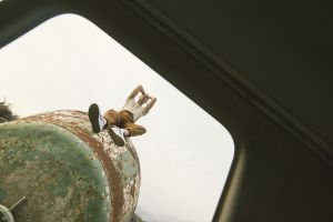 daylight wear metal person steel man sitting rusty water tank
