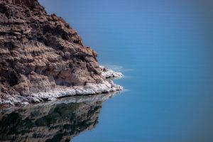 deep sea landscape reflection scenic geology water seashore sunset beach rock