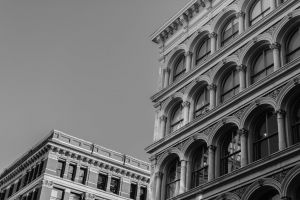 downtown grayscale exterior art black-and-white low angle shot urban facade windows building