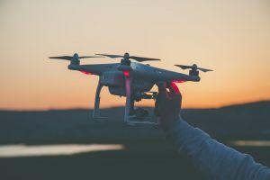 drone focus close-up dawn blur hand