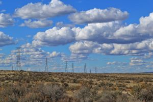 electrical post landscape ecology sky environment light electricity field energy clouds
