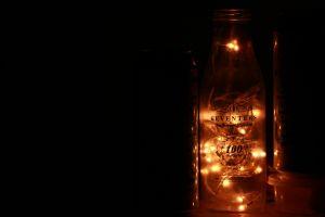 evening drink string lights dark black background illuminated glass led lights blur