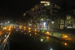evening tropical appartments water night light reflections bright buildings reflection canal
