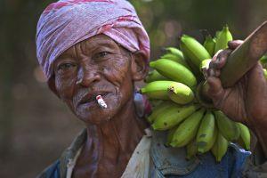 farming facial expression food environment market wear man banana adult grow