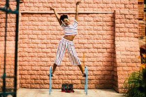 fashionable pose woman fashion bricks stones exterior model girl stripes