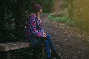 female nature model bench woods tree photoshoot fashion bonnet beanie