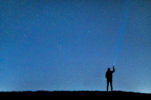 flashlight stars person human night night sky long-exposure shooting stars man sky
